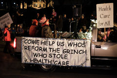 Grinch Who Stole Health Care advocates in holiday parade. Corvallis, OR, Nov 28, 2015: Truck carries musician and advocates for universal health care in holiday Royalty Free Stock Image