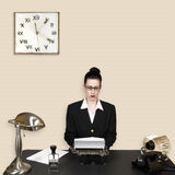 Daily Grind. Retro office worker in vintage corporate environment royalty free stock photos