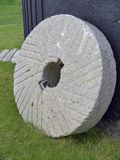 The daily grind... Millstone at Sussex windmill stock image