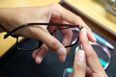 Grind the lens into the eyeglass stock photography
