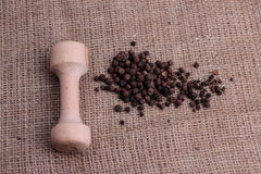 Grind pepper on a sacking. Grind black pepper on a sacking Royalty Free Stock Images