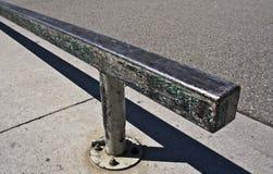Grind Rail. This is a metallic grind rail at an urban skate park Stock Photos