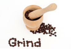 Grind word & coffee beans,mortar,& pestle on white Stock Image