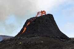Free Grindavik, Iceland, March 23, 2021: People Are Watching The Volcano Eruption At Fagradalsfjall Royalty Free Stock Image - 214225786