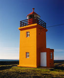 Grindavik Lighthouse. In Iceland. Bright Orange with a blue sky background Royalty Free Stock Image