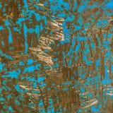Grinded与蓝色油漆残余的金属纹理  库存图片