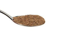 Grinded black pepper (Piper nigrum) on a teaspoon. Grinded black pepper on a teaspoon on a white background Royalty Free Stock Photography