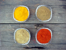 Grinded spices in glass bowl on rusted wooden. Indian grinded spices in the crystal bowl Royalty Free Stock Photo