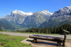 Grindelwald and Wetterhorn, Schreckhorn and Eiger. View at the village Grindelwald with the famous mountains the Wetterhorn, Schreckhorn and Eiger. Water trough stock photo