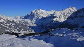 Grindelwald in winter and ski slopes Stock Images