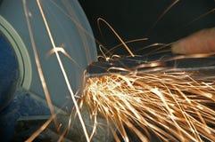 Grinder 1. Grinder with flying sparks in workshop royalty free stock photo