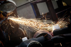 Grinder. At work in industrial surrondings Royalty Free Stock Photos