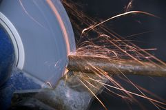 Grinder 2. Grinder with flying sparks in workshop stock image
