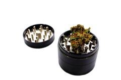 Grinder. Isolated black and silver grinder used to crush and grind herbs Stock Photo