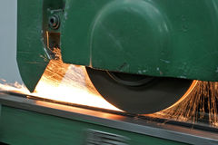 Grinder. A grinder polishing a metal plate Royalty Free Stock Photos