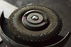 Grinder with abrasive disk Stock Image