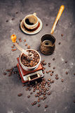 Grinder, cezve and coffee beans Stock Image