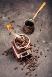 Grinder, cezve and coffee beans Stock Photography
