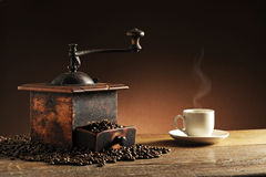 Grinder and coffee. Grinder, beans and coffee cup royalty free stock images
