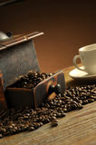 Grinder and coffee. Grinder beans and coffee cup stock photography