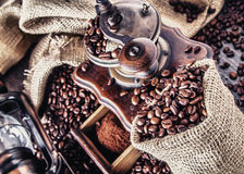 Old grinder and coffee beans Stock Photography