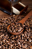 Grinder and coffee beans with a  spoon Royalty Free Stock Photography