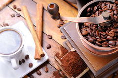 Grinder with coffee on a brown wooden table top view Royalty Free Stock Photography