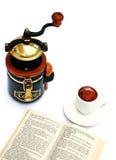 Grinder, cup, book Stock Photos