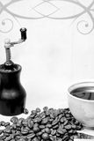 Grinder and cup of coffee Royalty Free Stock Images