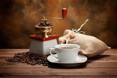 grinder för kaffekopp Arkivbild