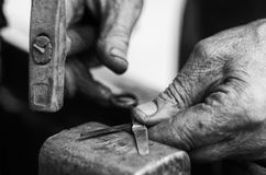 The grinder. The hands of a grinder fixing a pair of scissors Stock Photo
