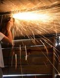 Grinder. Metal cutting grinder in dark garage Royalty Free Stock Photos