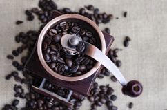 Coffee beans and a wooden grinder Stock Photography