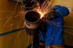 Grinder pipe work. In workshop Stock Photo