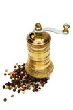 Grinder with scattered grains of spices around Royalty Free Stock Photos