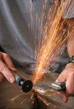 Grinder sparks. Sparks flying from a grinder royalty free stock photo