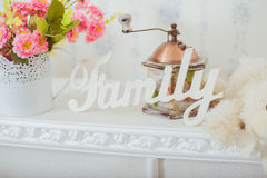 Grinder and a vase of spring flowers in the style Shabby chic Stock Photos