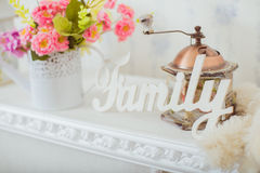Grinder and a vase of spring flowers in the style Shabby chic Royalty Free Stock Images