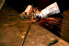 Grinding. Welder grinding tube after welding royalty free stock photography
