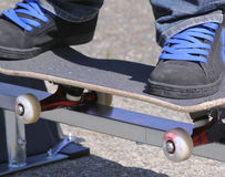 Grinding. A youth skateboarder grinds the rail in preperation for the skate park Royalty Free Stock Images