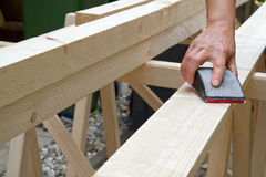 Free Grinding A Wooden Beam Royalty Free Stock Photography - 20660447