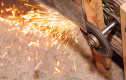 Grinding Blade with flame in factory. Day time Royalty Free Stock Photography