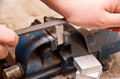 Grinding a block of metal Stock Photo