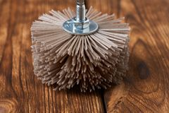 Grinding brush nylon for a drill on a wood background stock photo