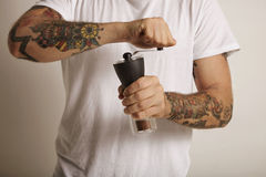 Grinding coffee with a manual grinder royalty free stock photos