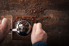 Grinding coffee on the wooden table Stock Photos