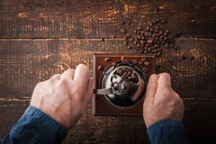 Grinding coffee on the wooden table  top view Stock Images