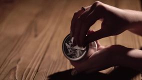 Grinding cones of marijuana with a grinder close-up. Weed buds and grinder in details Slow motion stock footage