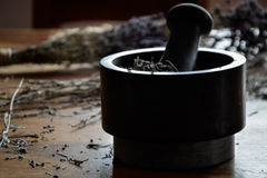 grinding and crushing of dried lavender with a mortar Stock Images