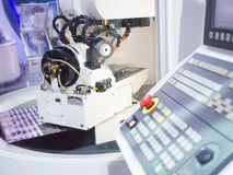 Grinding cutting tool by grinding machine Royalty Free Stock Image
